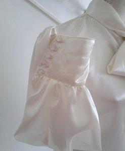 Ivory satin blouse close up