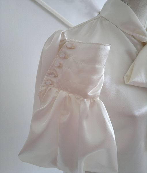Ivory satin blouse close up