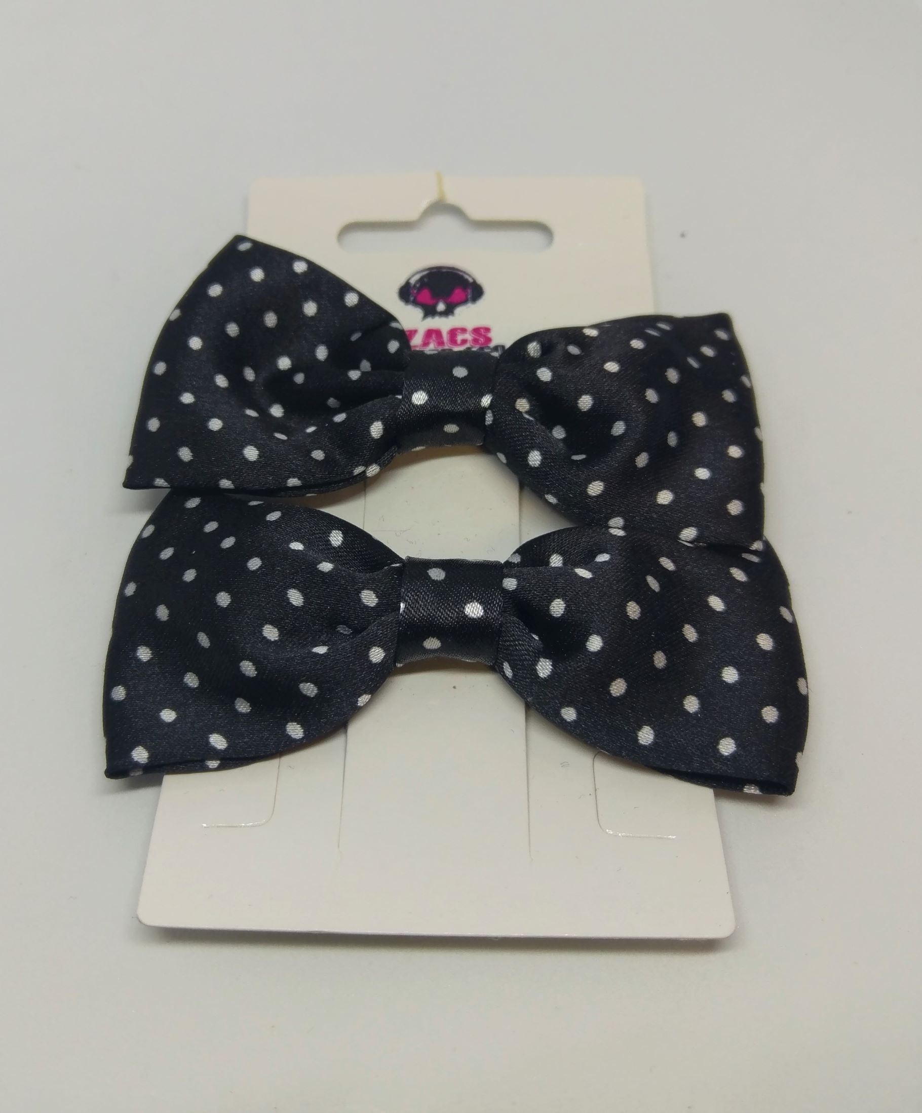 Black & White Polka Dot Hair Clips great for retro pin up and alternative wear.